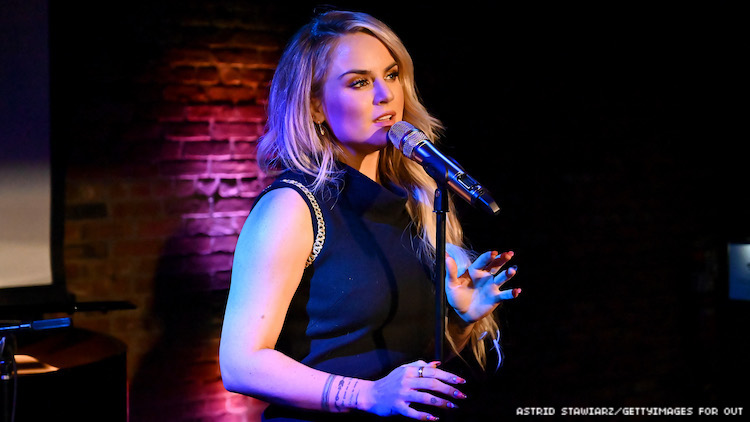 Jojo singing in a mic at the OUt100 event.
