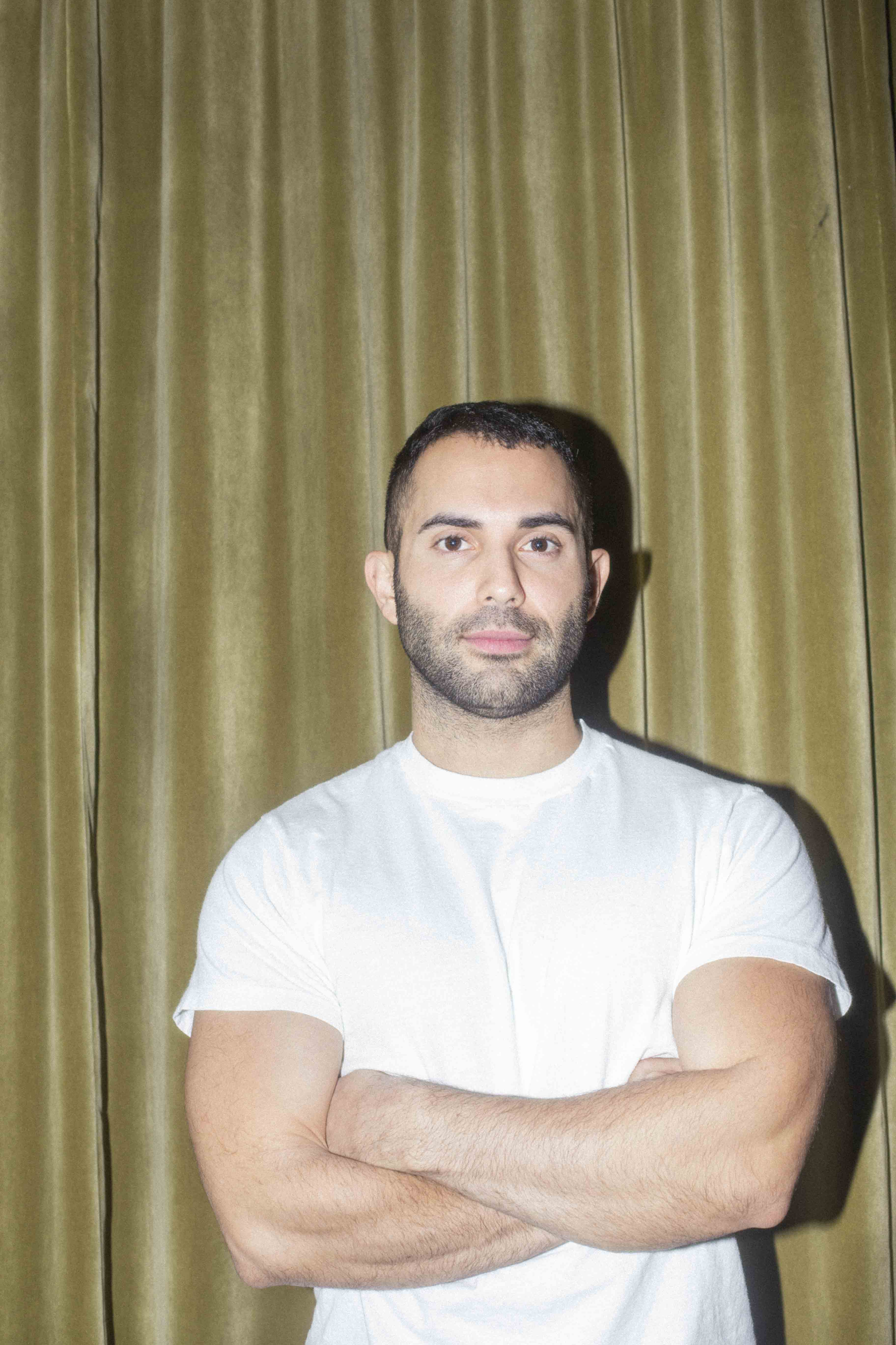 Andy Baraghani in a white t-shirt.