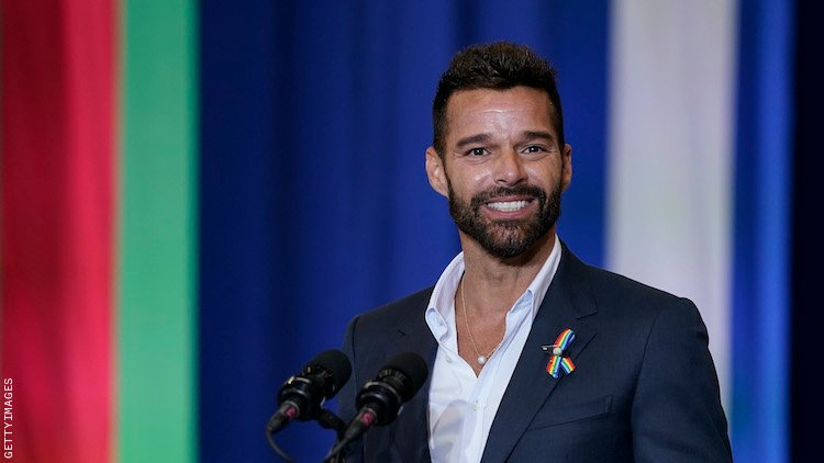 Ricky Martin speaking at a rally.
