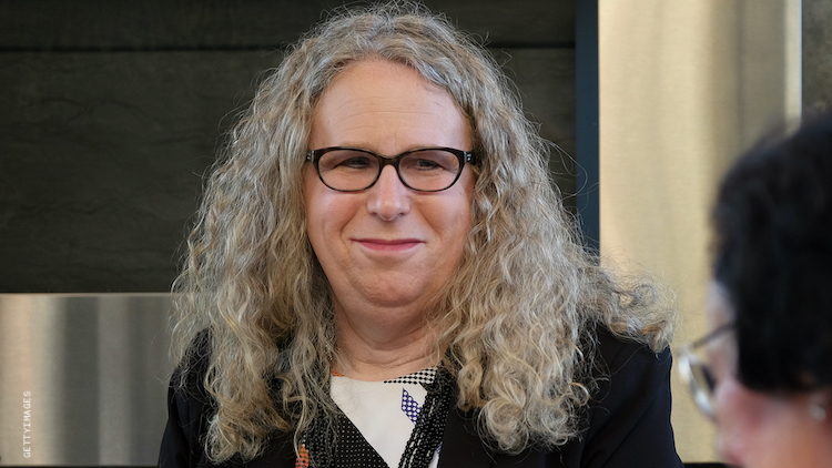 Dr Rachel Levine sitting, smiling at a table.