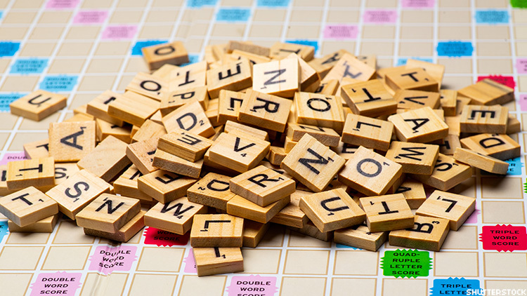 Official group wants to remove racist and homophobic slurs from board game Scrabble.