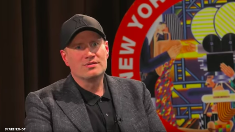 Kevin Feige sitting down and speaking with a hat on.