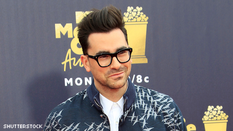Dan Levy on a red carpet.