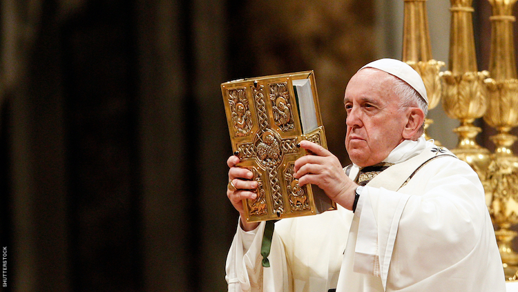 POPE FRANCIS WITH A BIBLE.