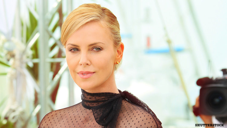 Charlize Theron on Cannes red carpet