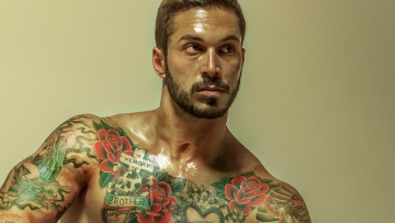 Alex Minsky and Mr. Leather Pose for The Hunger Games Posters