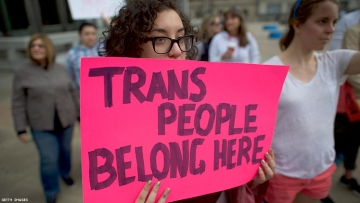 """""""Trans people belong here"""" protest sign"""