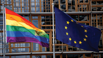 European Union Flag and Pride Flag flying