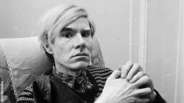 Andy Warhol sits for a portrait.