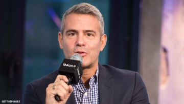 Andy Cohen speaking on a mic.