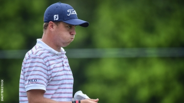 Justin Thomas looking disappointed wearing Ralph Lauren Polo