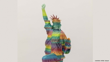 sculpture by peter szalay lady liberty kneeling with fist in air and Black Lives Matter written on her tablet