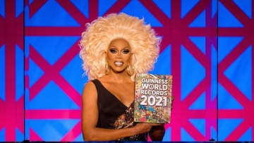 RuPaul holding Guinness World Records book.