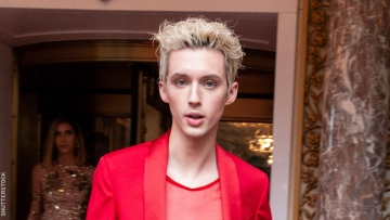 Troye Sivan on red carpet in all red.