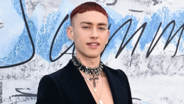 Olly Alexander on a red carpet.