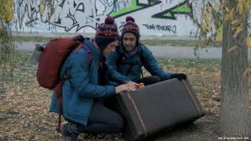 Will and James of 32nd The Amazing Race at the Berlin Wall