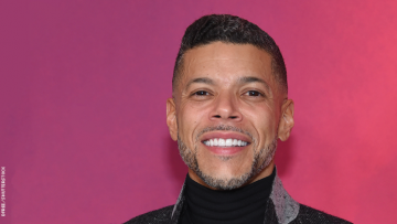 Wilson Cruz on a red carpet.