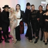Amanda Lepore and R. Kurt Osenlund pose with guests