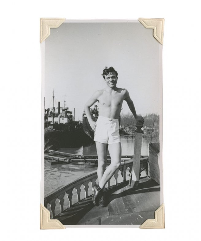 4. Scotty Bowers just after World War II with a naval vessel in background.