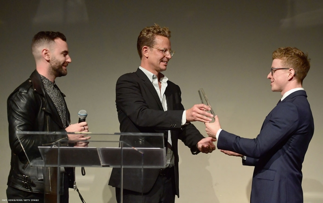 Tyler Oakley (R) accepts the Power of Originality Award