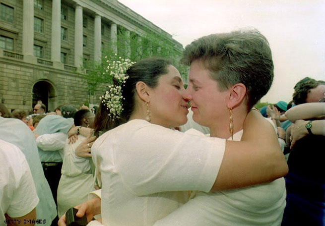 1993 - A lesbian couple embrace after exchanging wedding vows at an interfaith commitment ceremony in front of the IRS building in Washington, DC
