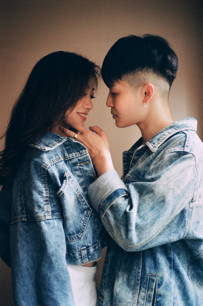 Two women about to kiss.