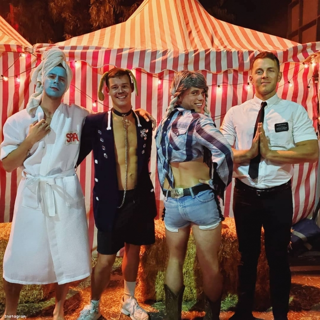 Gus Kenworthy and friends in costume at a carnival.