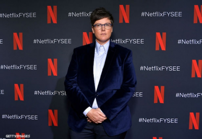Hannah Gadsby on a red carpet.