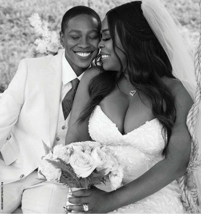 Niecy Nash and wife