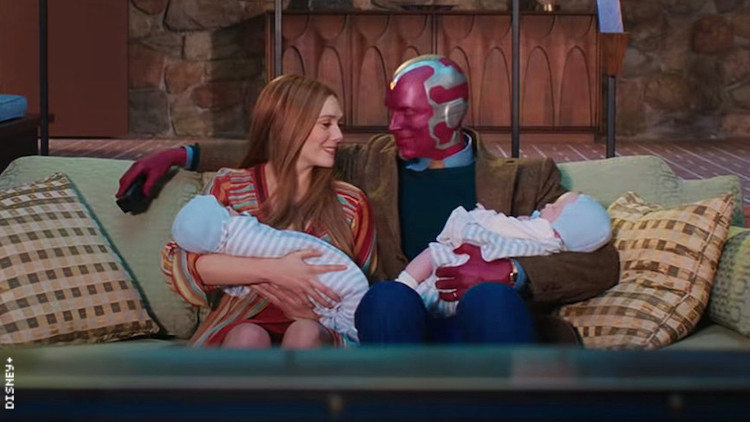 Wanda Maximoff and Vision holding their twin sons