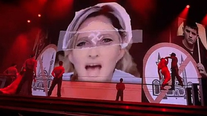 French Politician Ready to Pounce on Madonna, Her Dad Asks for $1 Million in Apology