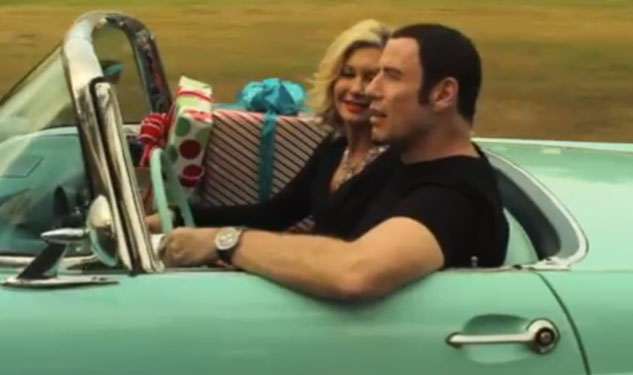 WATCH: Olivia and Travolta Sing About Coming Home
