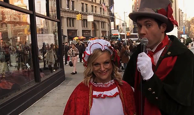 WATCH: Billy Eichner and Amy Poehler Sing Carols With Strangers