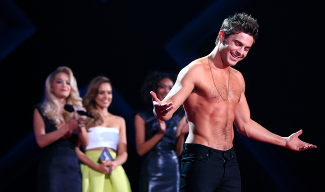 Zac Efron Loses His Shirt at MTV Movie Awards