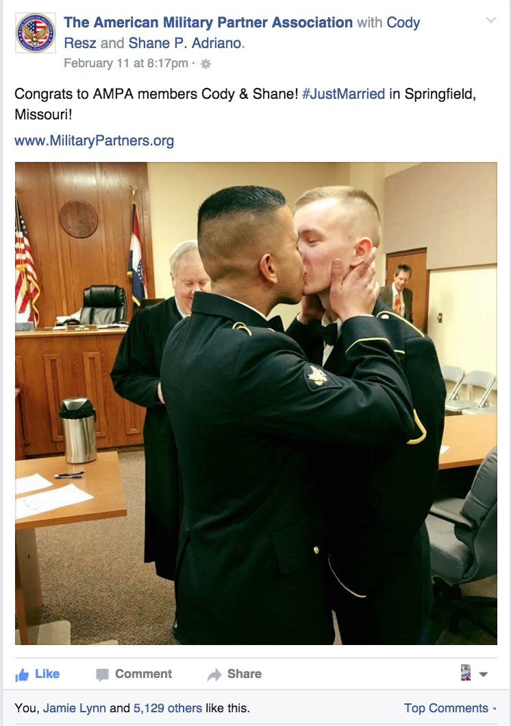 Military kiss shared by American Military Partner Association.