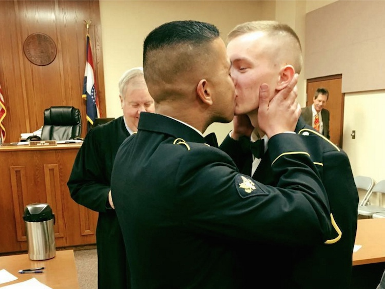 Military service members celebrate their marriage.