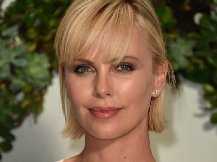 Charlize Theron aids conference