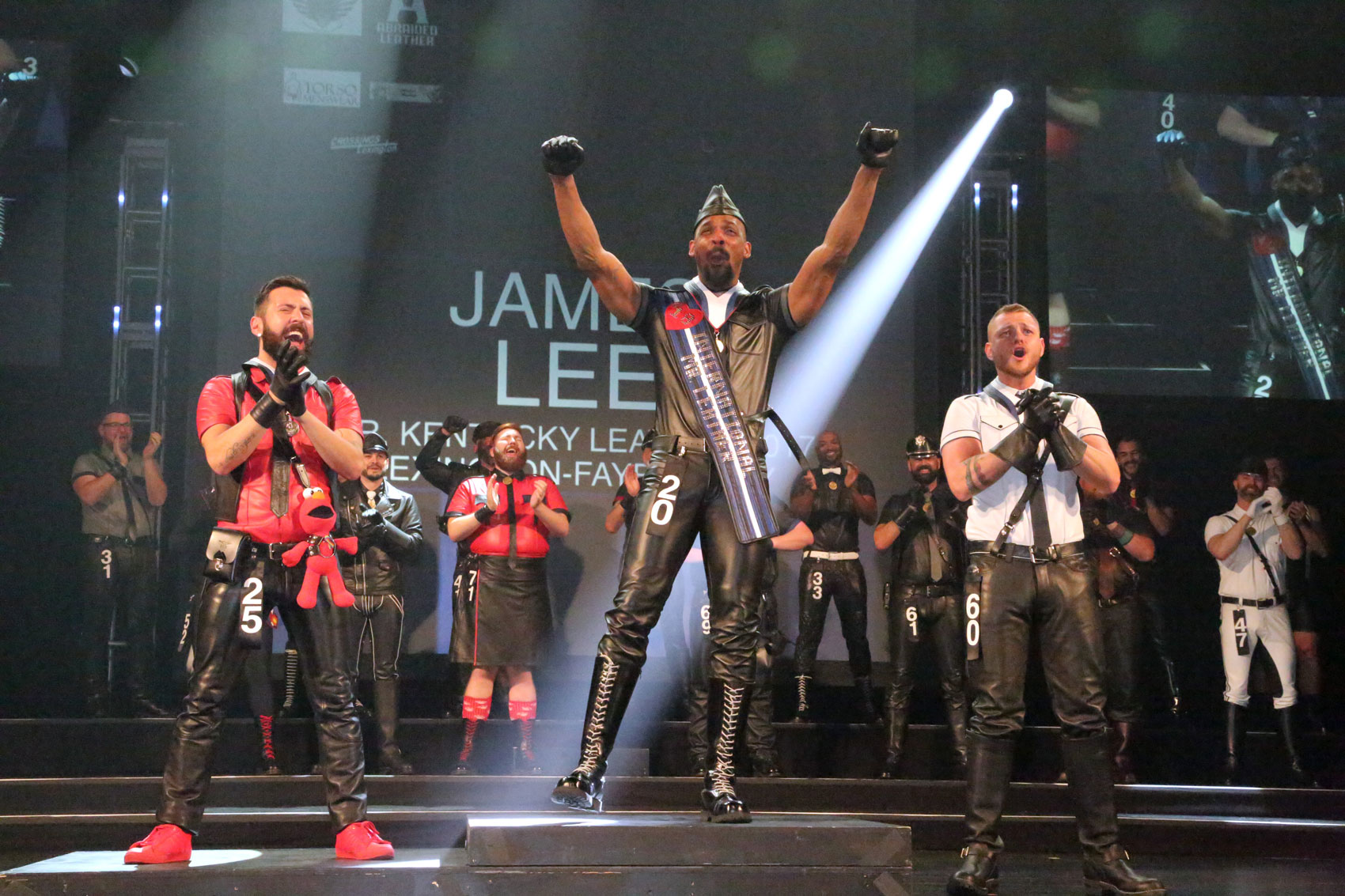 Mr Kentucky 2017 James Lee (center) named International Mr Leather 2018 with first runner up Mr Leather Belgium 2017 Sandro Cossero (left) and second runner up Mr Friendly SF 2018 Stephan Ferris (right). Photo courtesy of IML, Inc.