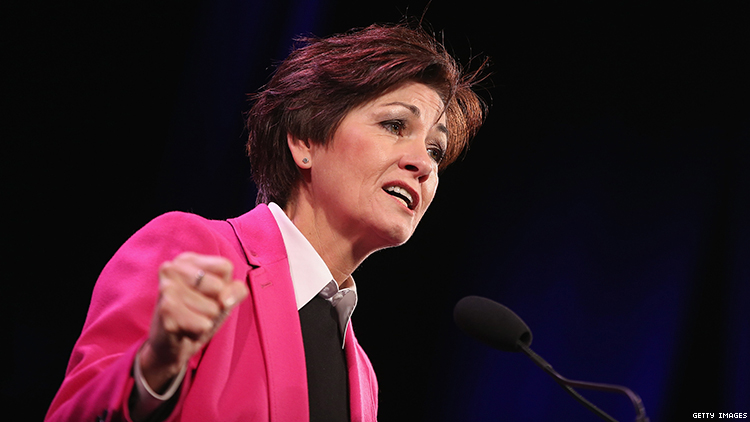 Iowa governor Kim Reynolds signs health care budget bill restricting transgender access and Planned Parenthood funding.
