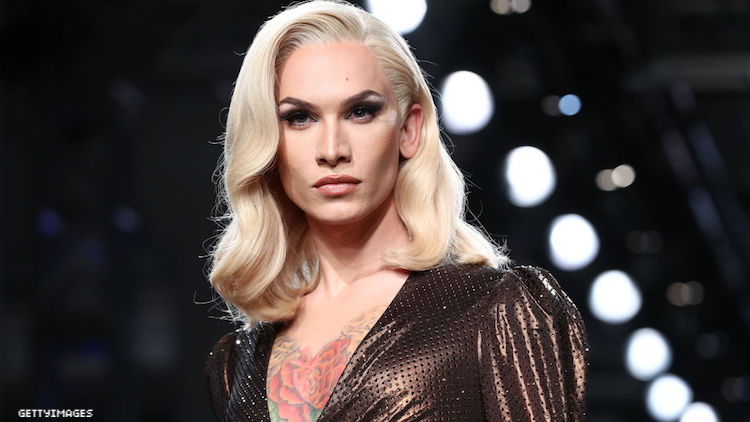Miss Fame walking in a fashion show.