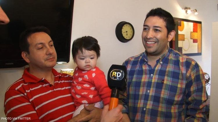 gay couple adopting baby living with HIV