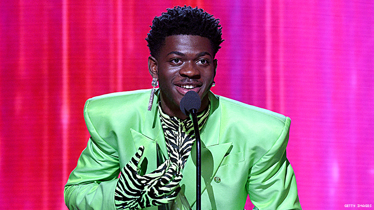 Lil Nas X wore a green suit to accept his AMA.
