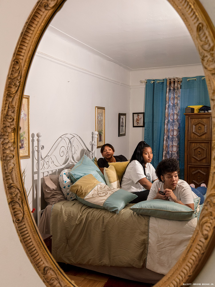 A photo of a mirror reflecting the home and family of Layleen Polanco.