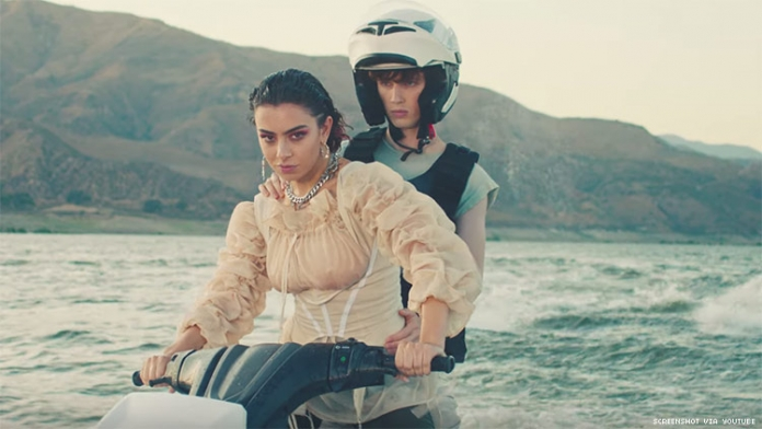 Charli XCX and Troye Sivan Jet Ski to the Future in '2099' Video