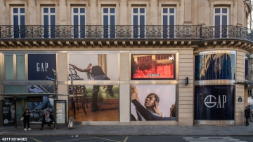 Gap storefront in Paris with Telfar Clemens in windows.