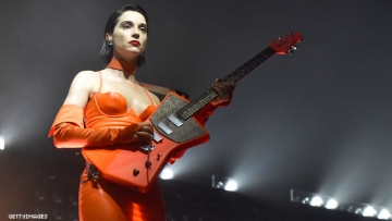St. Vincent performing at a concert.
