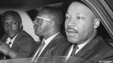 Bayard Rustin and Martin Luther King Jr. in a car.
