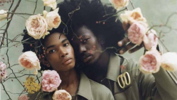 Two models wearing Fendi surrounded by flowers.