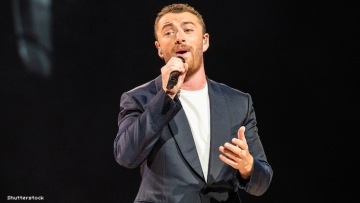 Sam Smith performing onstage in 2018.