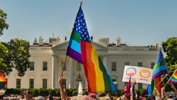 A Pride flag in front of the White House.